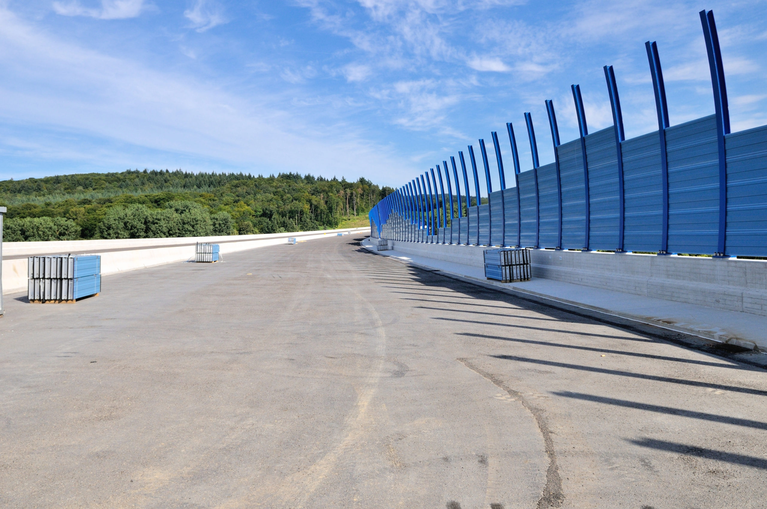 Creating a barrier alongside lines of communication to improve environmental acoustics